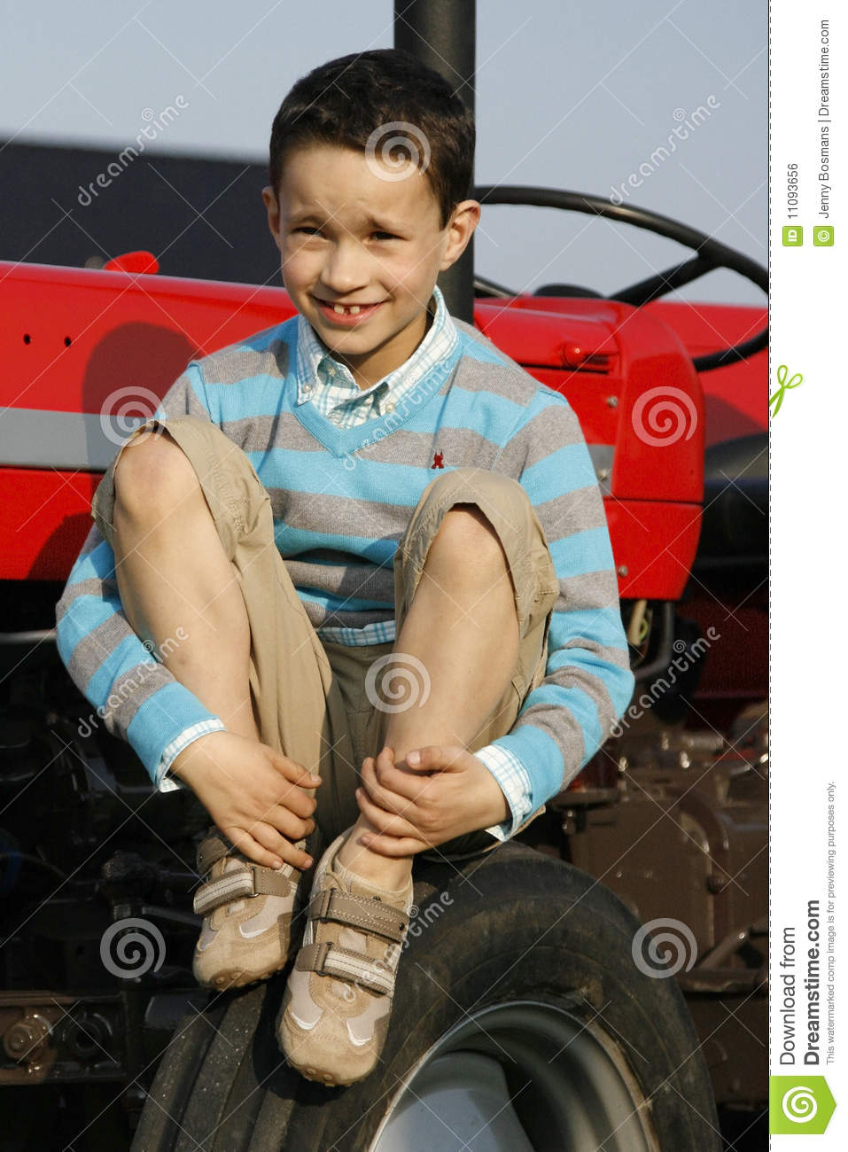 Boy On Tractor : Boy on tractor royalty free stock image