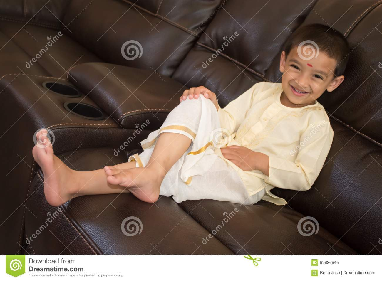 f89358c714 Boy with traditional south Indian dress on Onam day, Kerala, India,happy
