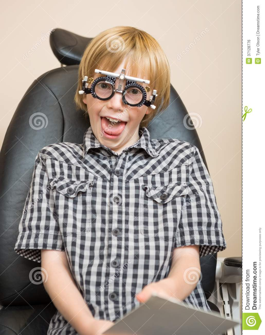 ... Free Stock Image: Boy With Trial Frame Making Funny Face At Optician