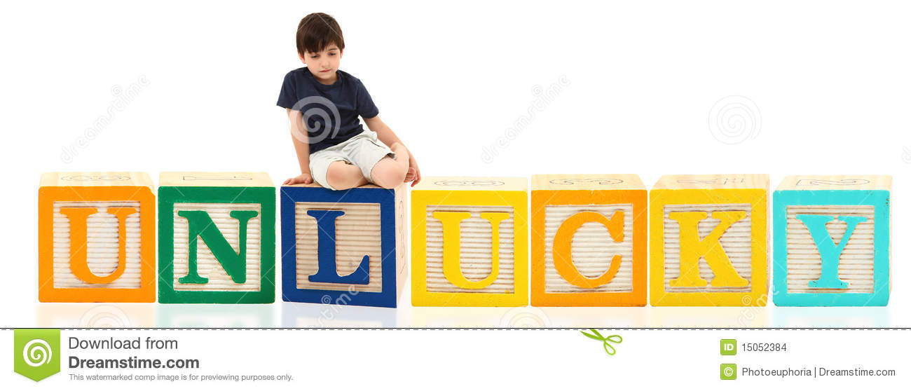 year old french american boy sitting on unlucky over white background