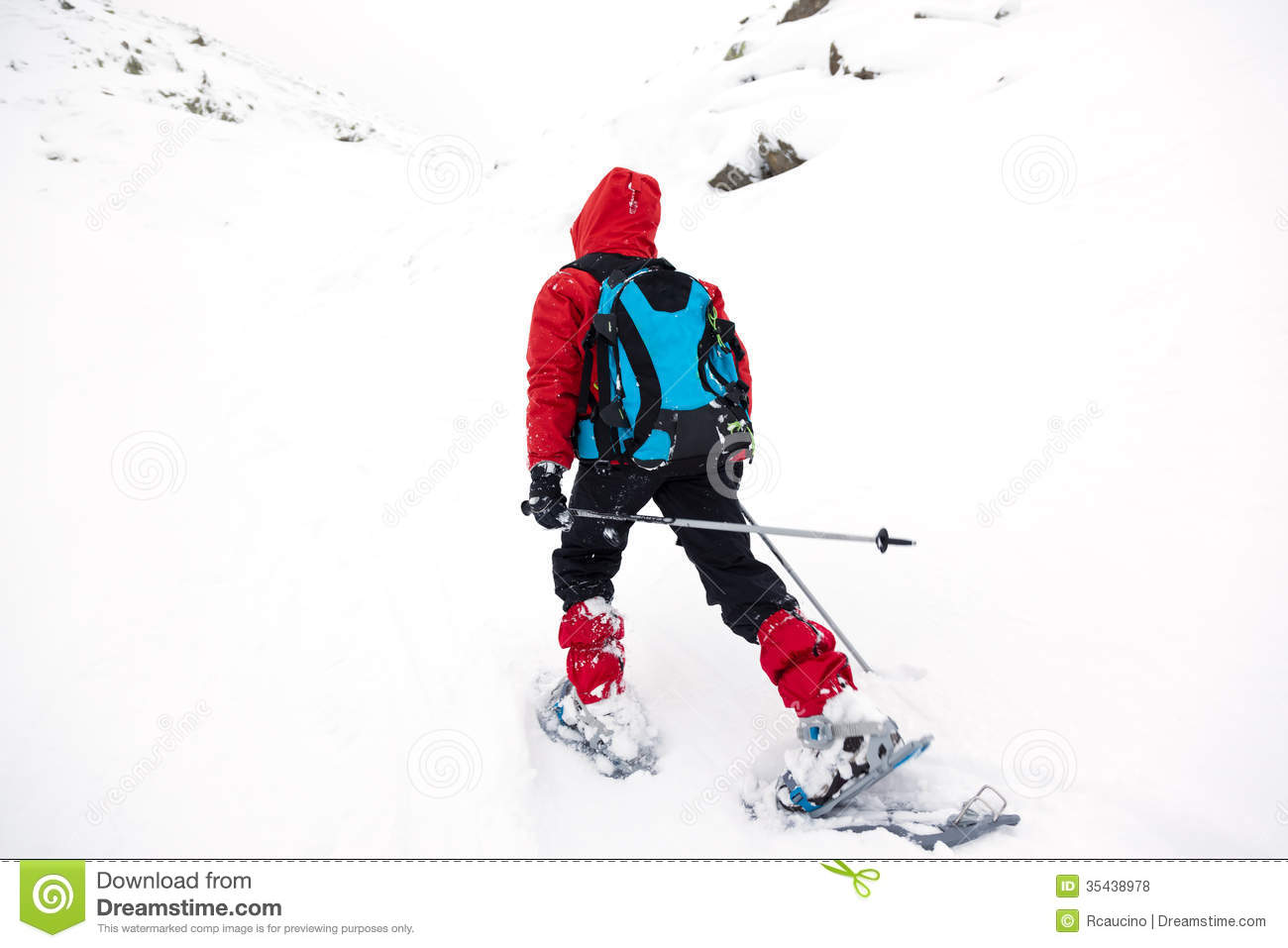Boy walking in mountain with snowshoe