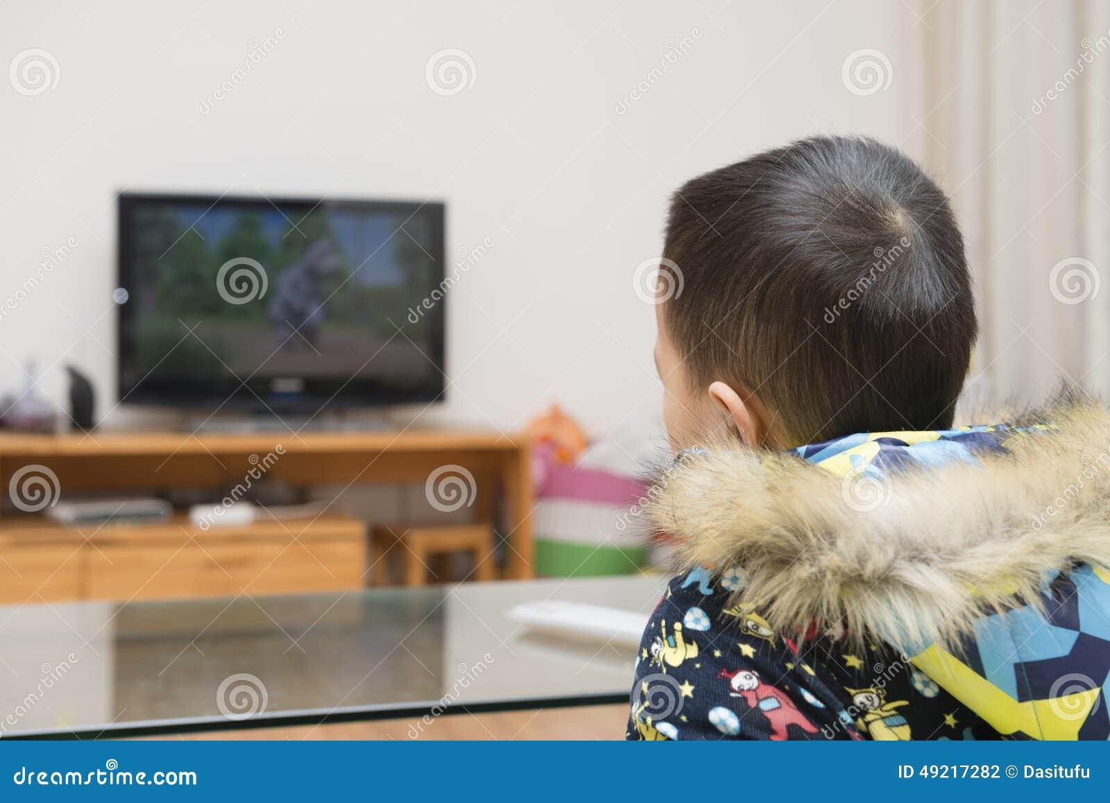 Boy watching cartoon TV