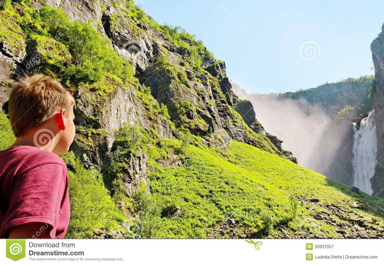 Boy at the waterfall.