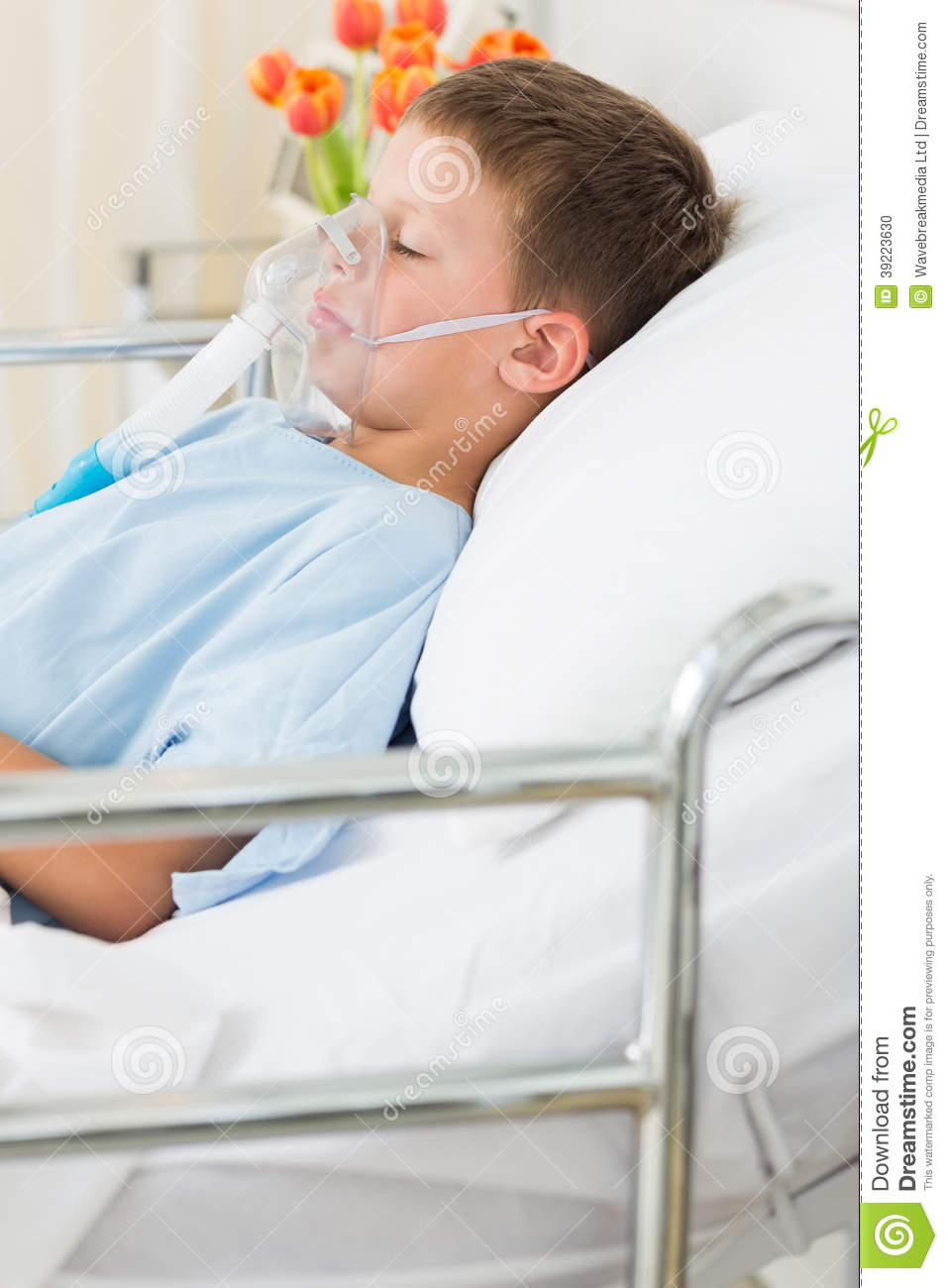 boy wearing oxygen mask in bed stock photo image 39223630
