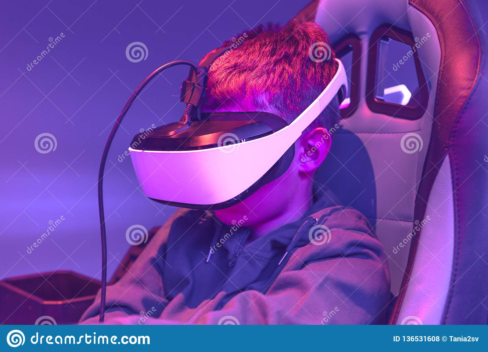 Boy wearing vr headset at virtual reality center