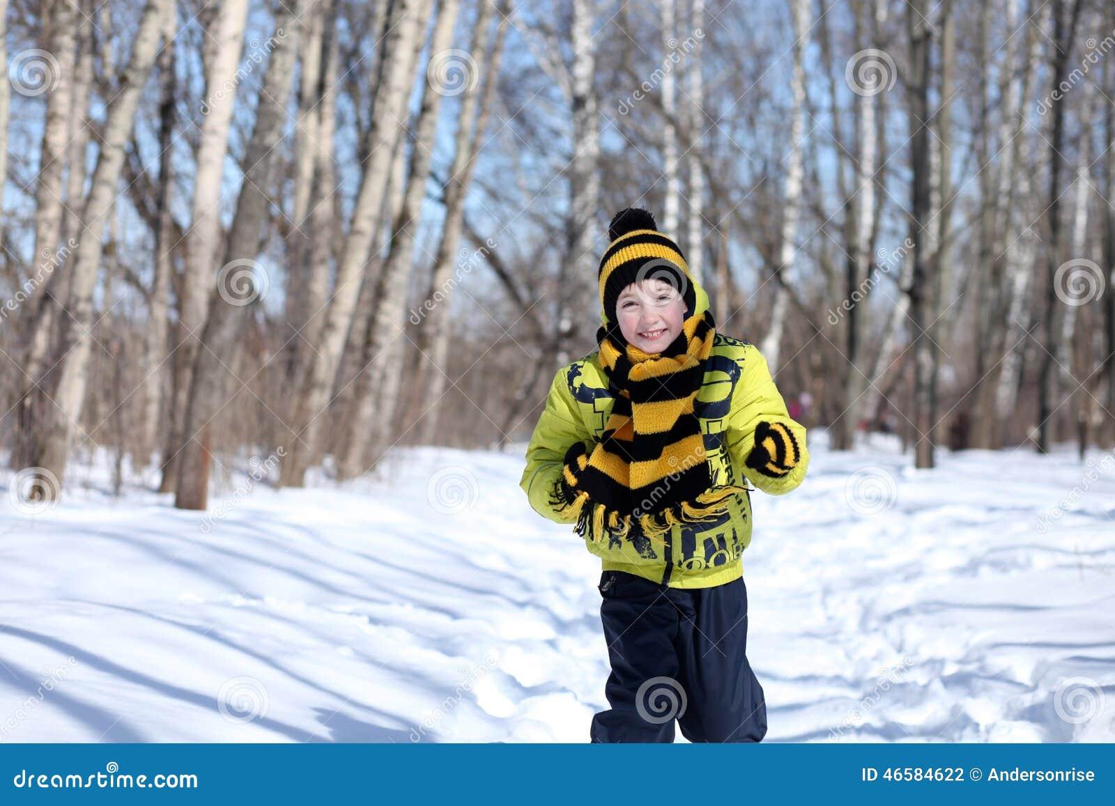 Boy in a winter park