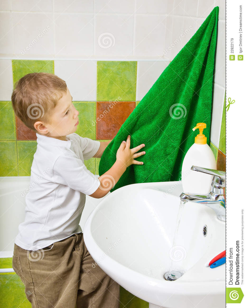 Boy Wipes Hands A Terry Towel After Washing Royalty Free