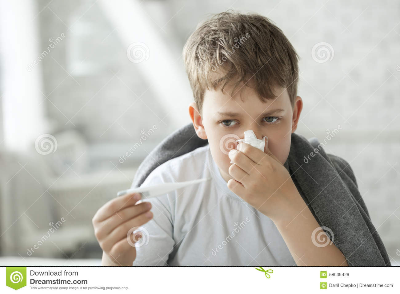 Boy Wipes His Nose With Tissue Stock Photo - Image: 58039429