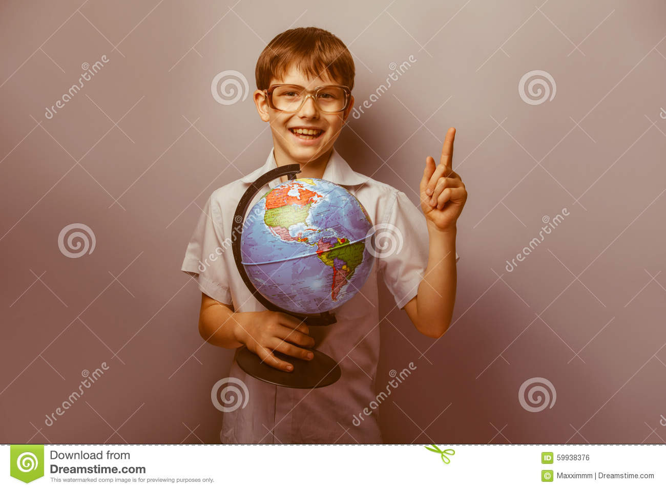 A Boy Of 10 Years Of European Appearance With Stock Photo