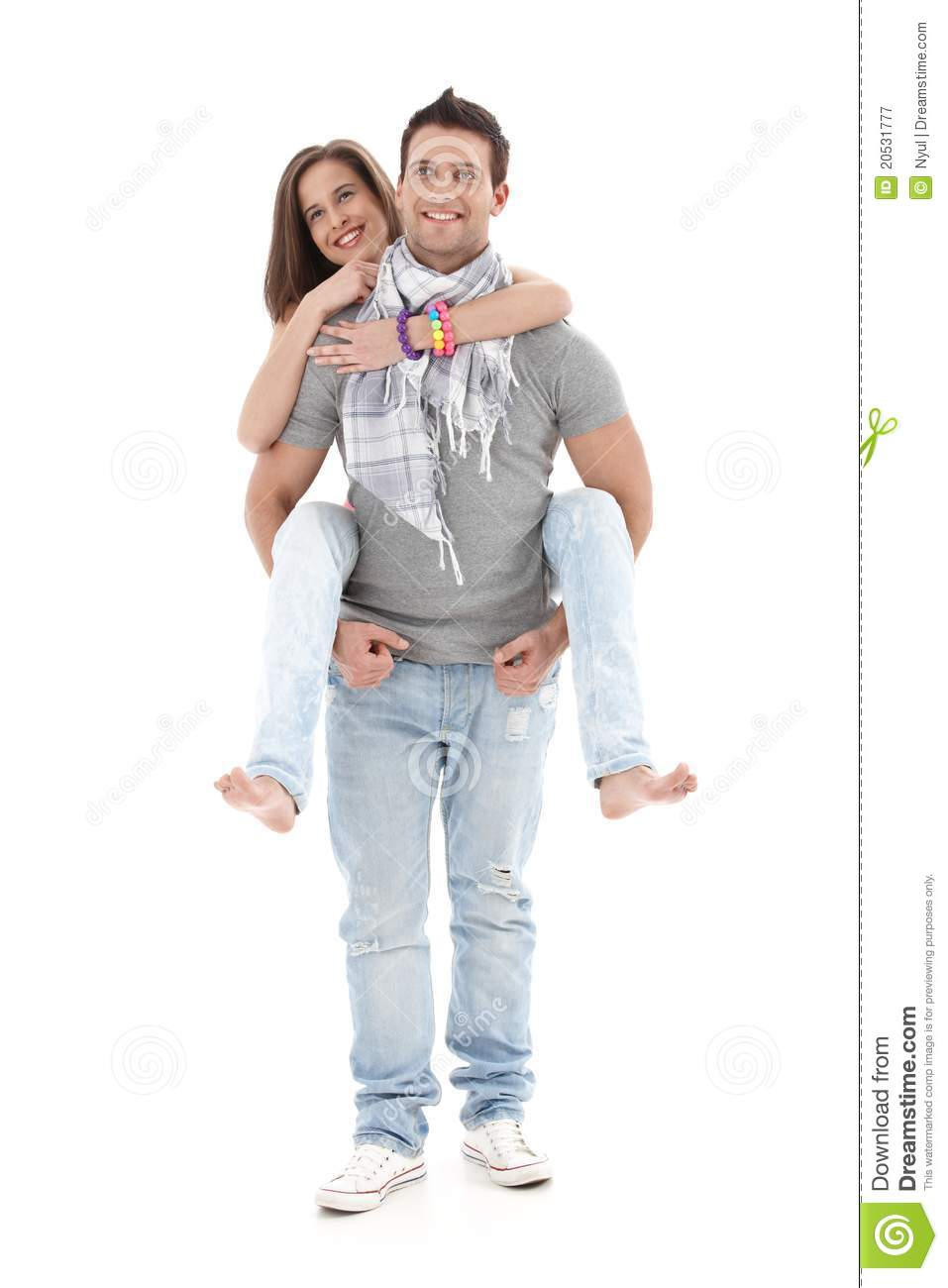 boyfriend carrying girl on back laughing royalty free
