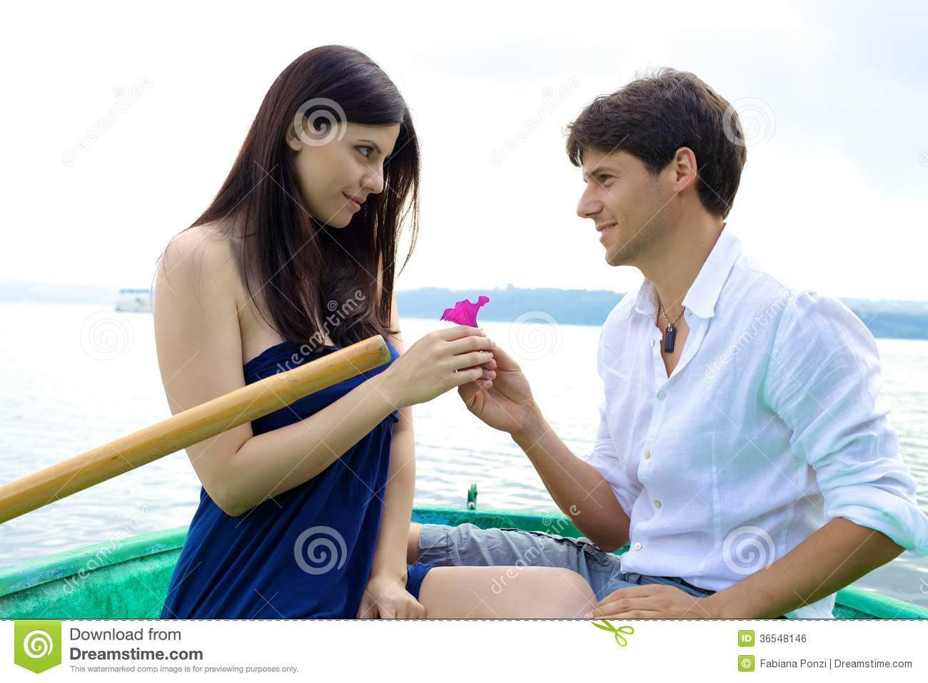 Girlfriend Love Wallpaper : Boyfriend Donating Pink Flower To Girlfriend In Love Stock Photo - Image: 36548146