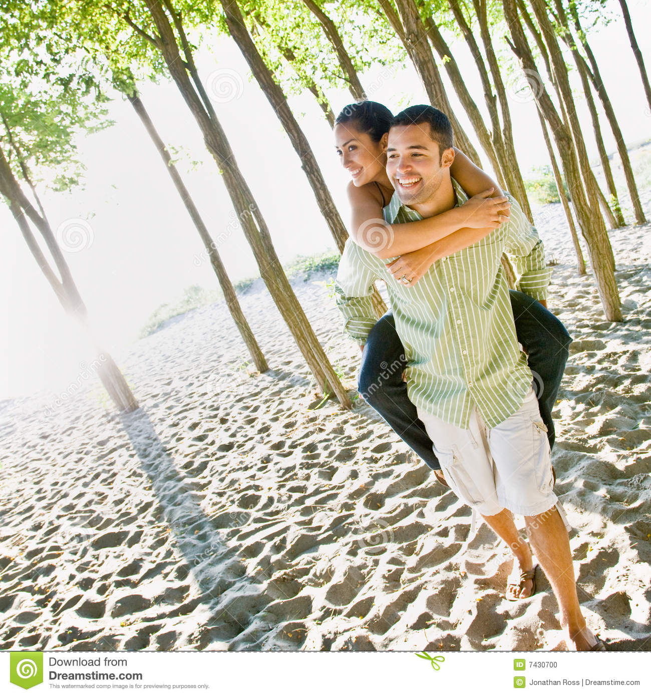 Boyfriend Giving Girlfriend Piggy Back Ride Stock Photo