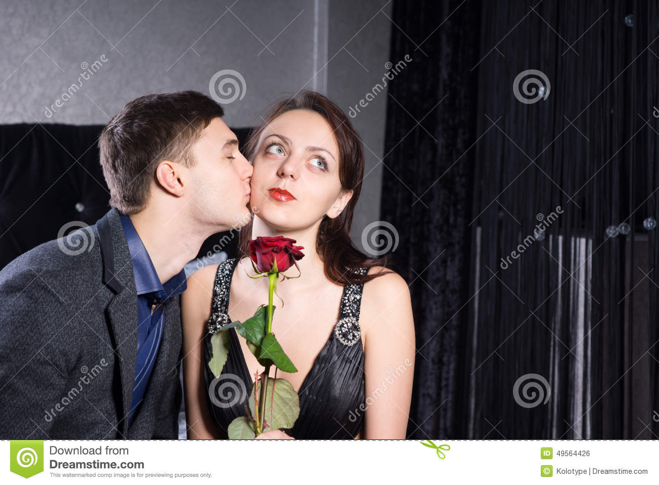 Boyfriend Kissing To Girlfriend With Rose Flower Stock Photo Image