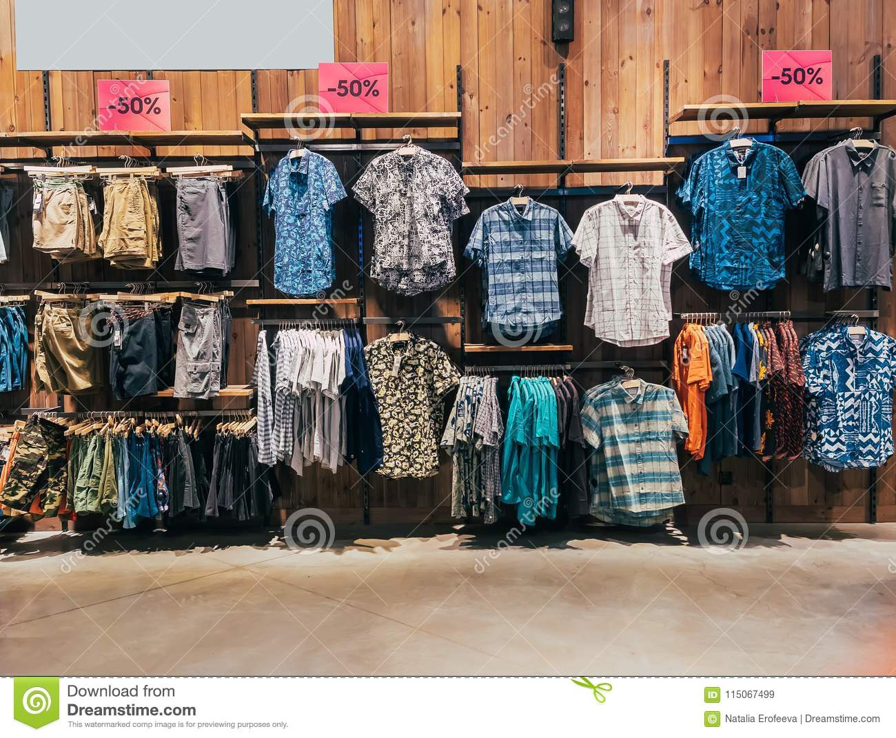 674209266 Boys department in clothing store. Shop of men`s clothing. Showcase rack  with