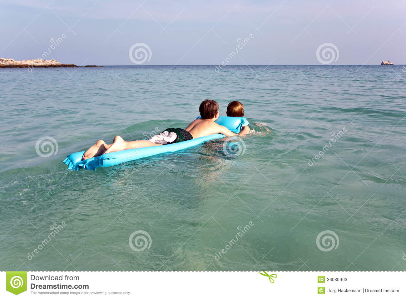 boys enjoy swimming in the ocean stock photos image