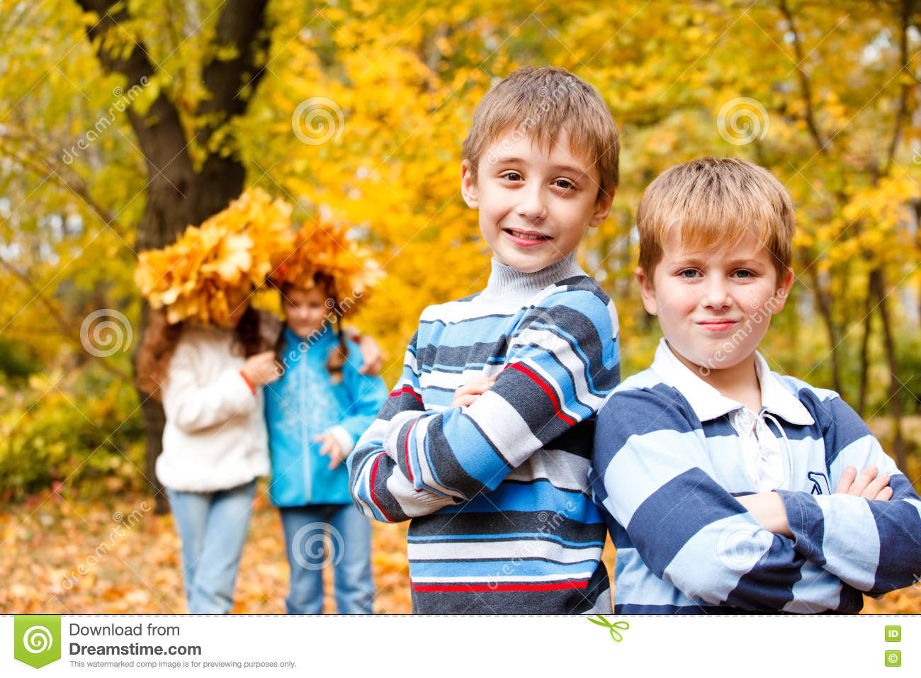 Boys and girls in autumn park