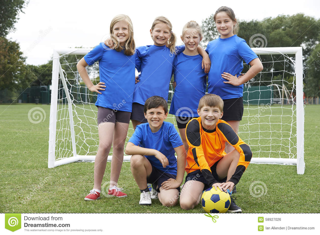 Boys And Girls In Elementary School Soccer Team Stock Photo - Image: 58927026