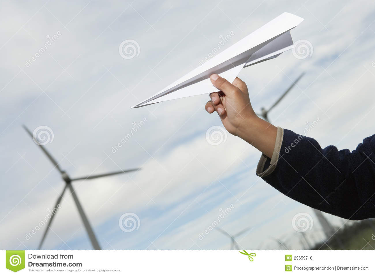 boys hand throwing paper plane stock photo