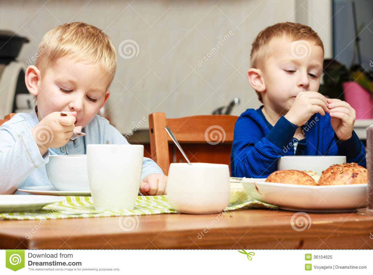 Boys Kids Children Eating Corn Flakes Breakfast Meal At