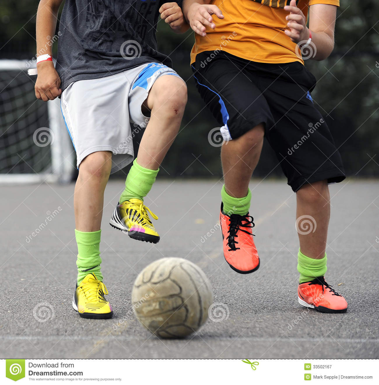 boys playing footbal royalty free stock photography