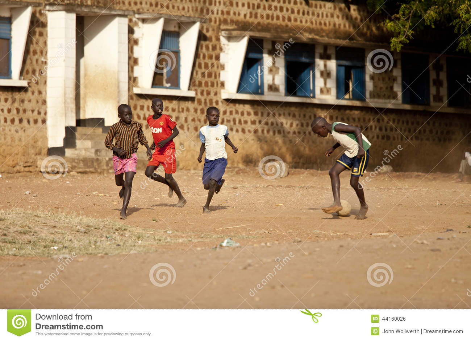 Boys playing soccer, South Sudan