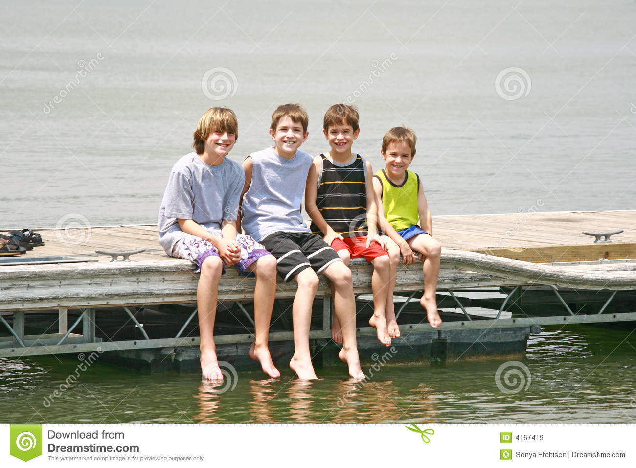 Boys Sitting On The Dock Royalty Free Stock Images Image