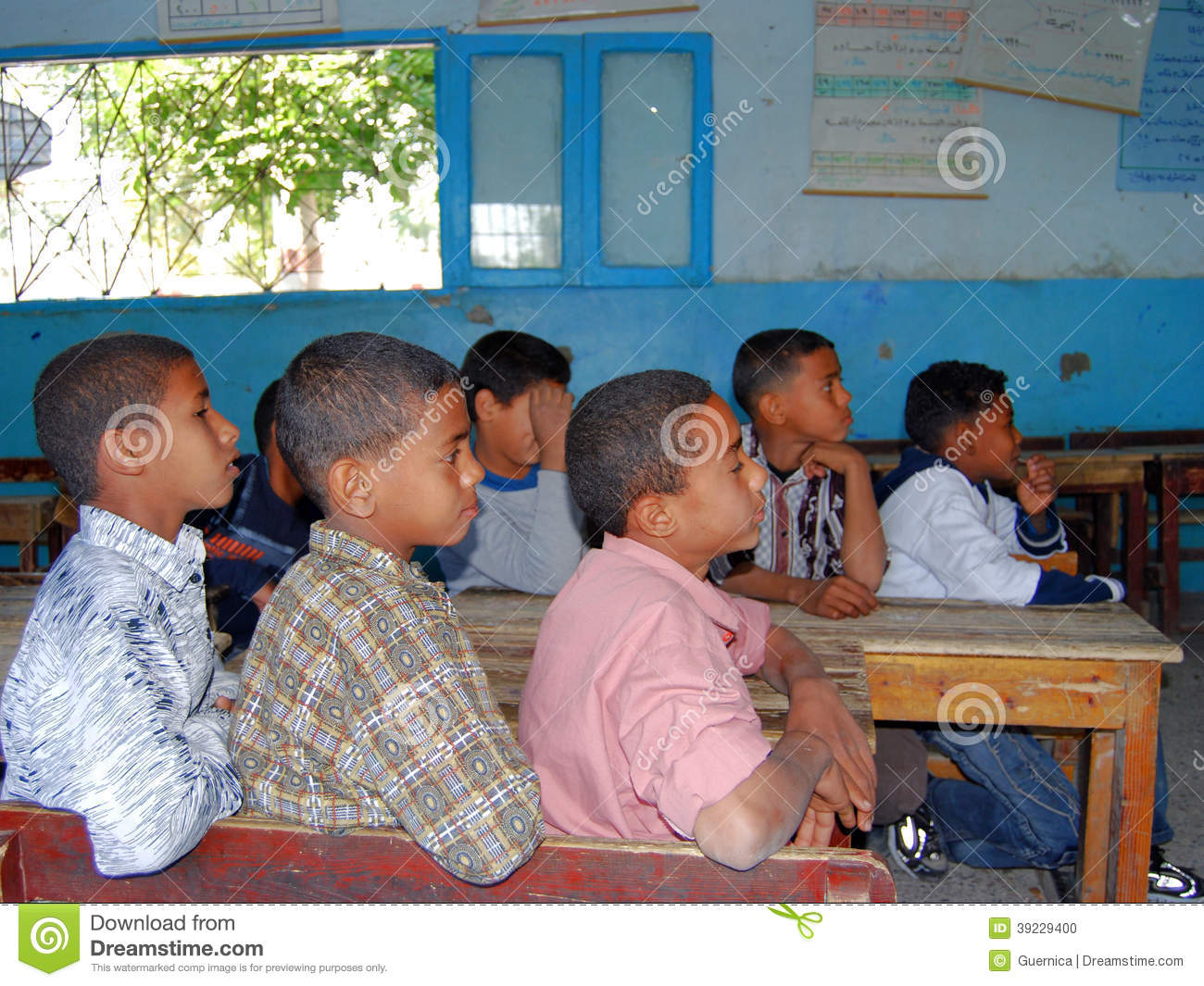 Boys Sitting On Their Disks At School In Egypt Editorial