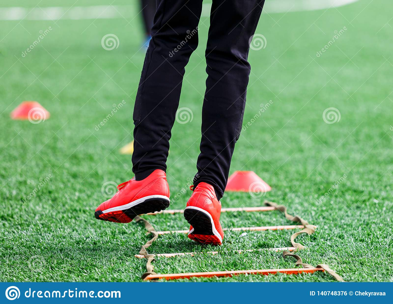 Boys in sportswear running on soccer field. Young footballers dribble . Training, active lifestyle, sport, children activity
