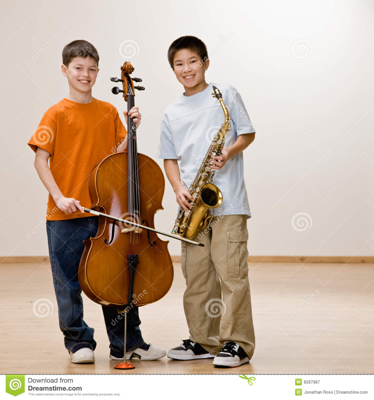 Boys Standing With Cello And Saxophone Royalty Free Stock ...