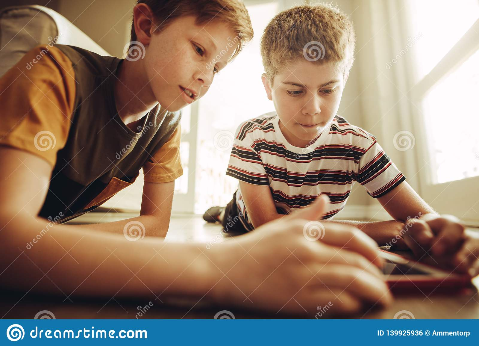 Boys using tablet pc