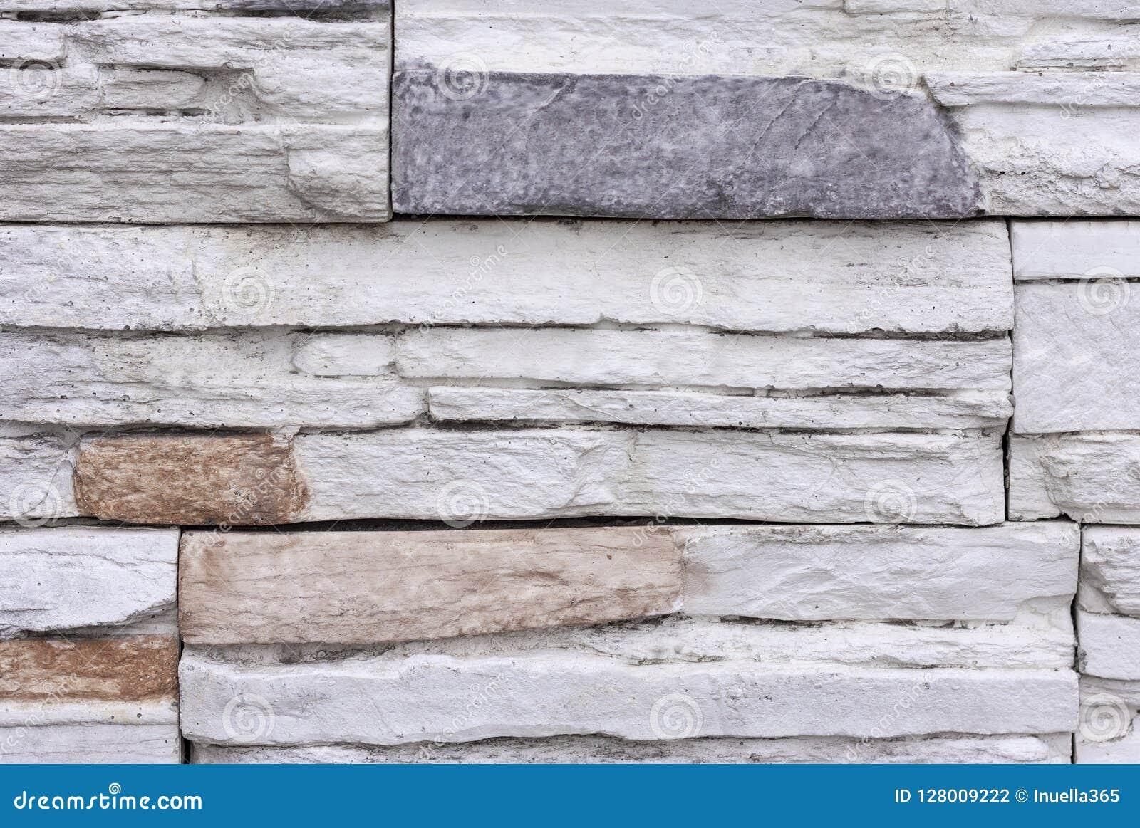 Bräde bildad konkret textur Bakgrund för stenvägg med färgrika beståndsdelar