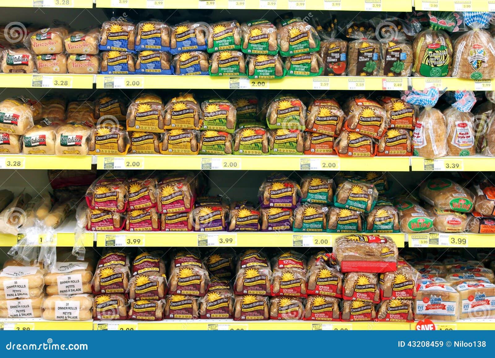 Download Bröd i livsmedelsbutik redaktionell fotografering för bildbyråer. Bild av många - 43208459