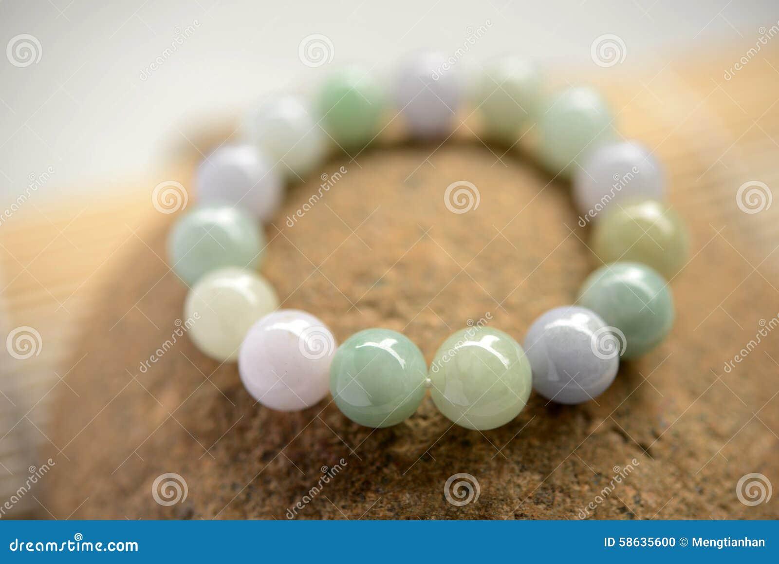 3bad55e277cf1 A Bracelet Of Glittering Jade Beads Stock Photo - Image of jadeite ...