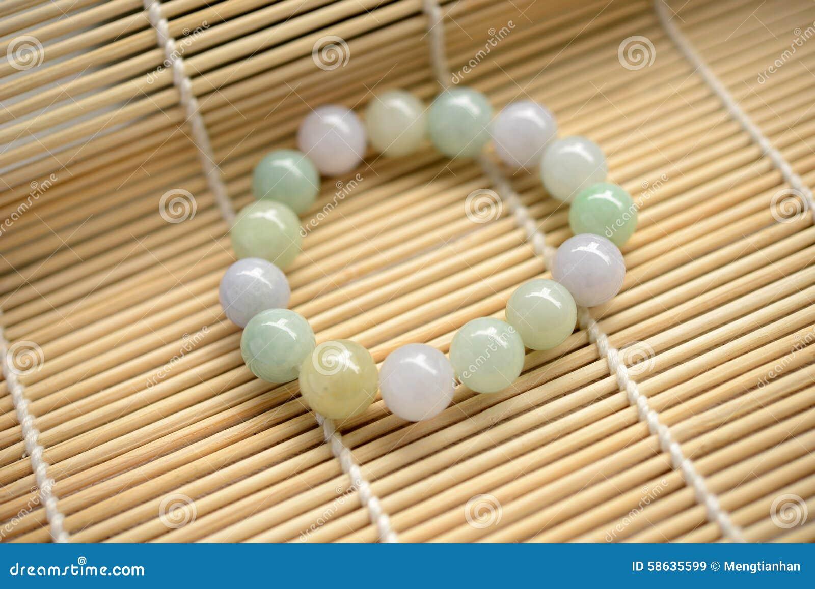 47a61ebc67c82 Bracelet of jade beads stock image. Image of life, beauty - 58635599