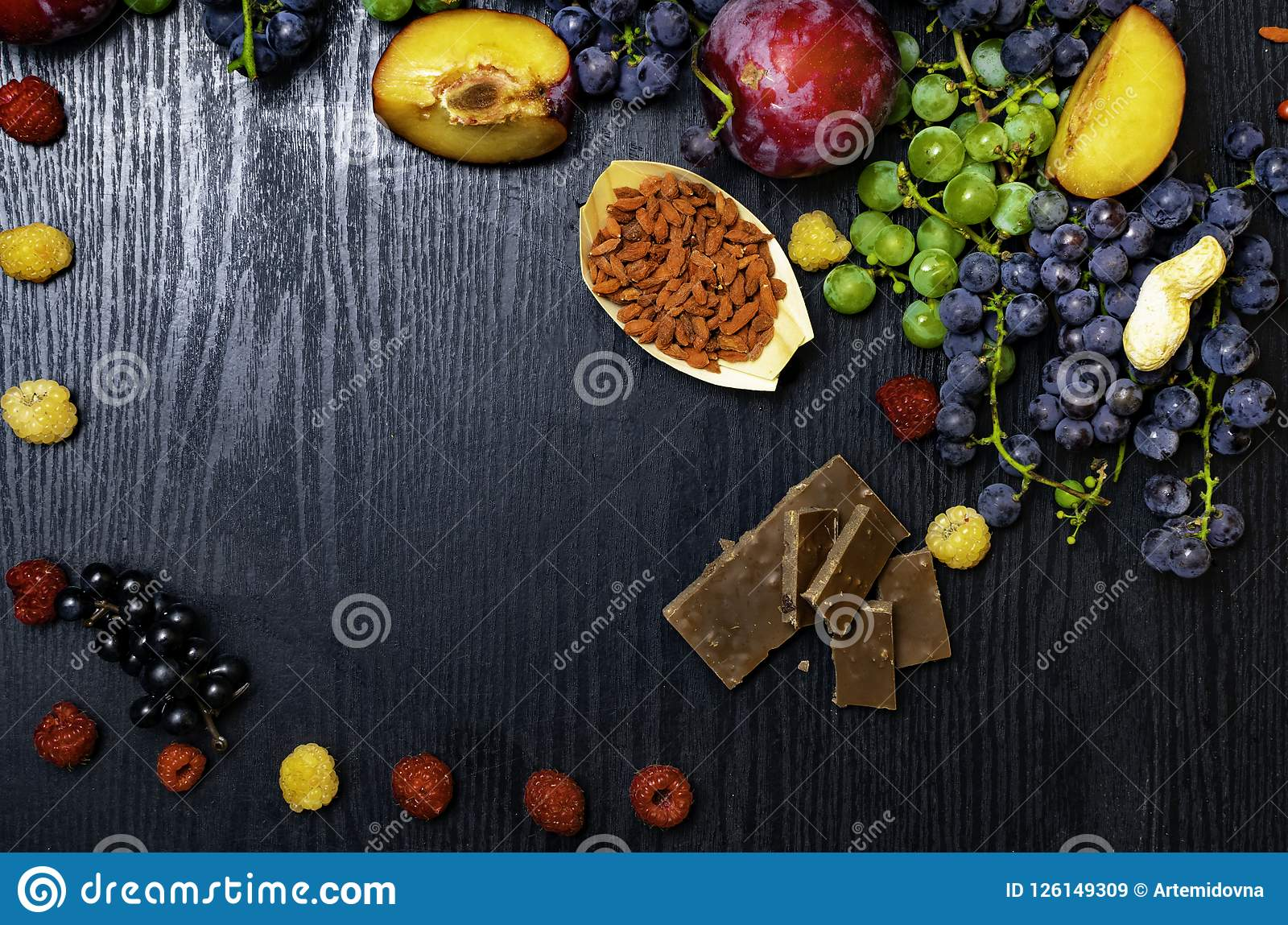 Brain boosting health food background border with fruits, nuts,berry. Foods high in vitamin C, vitamins, minerals, antioxidants an