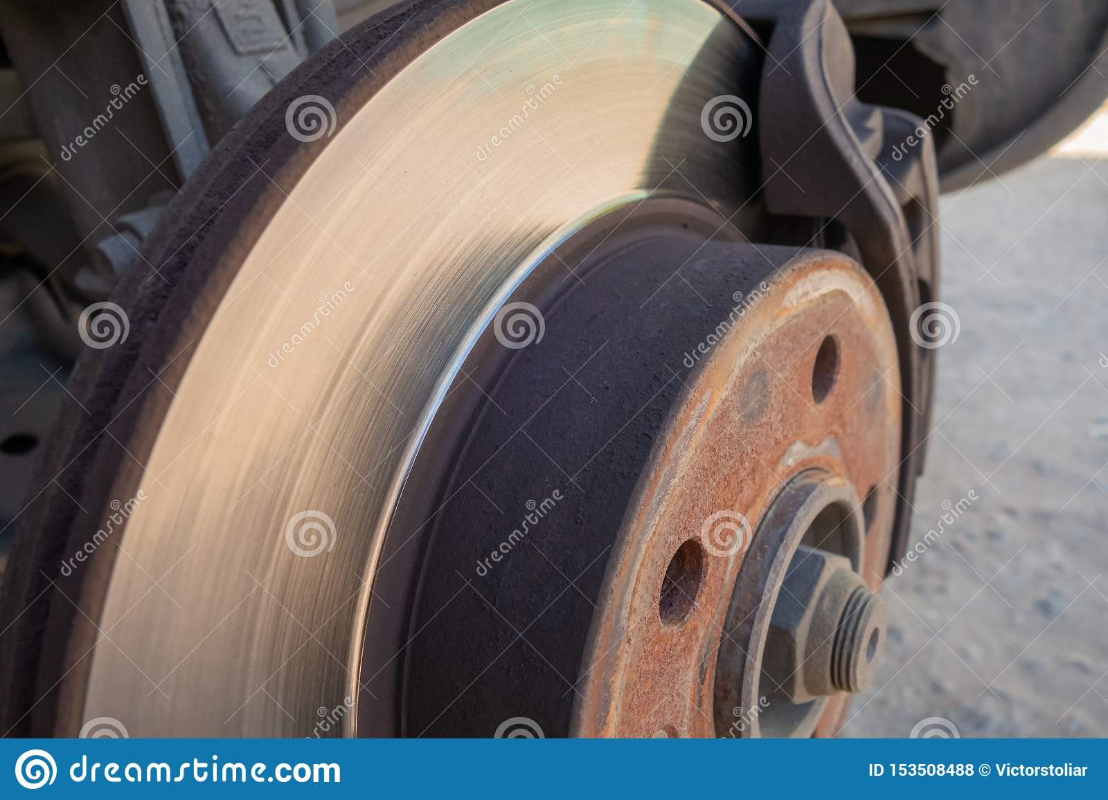 Brake disc and car caliper. The picture with the wheel removed for tire