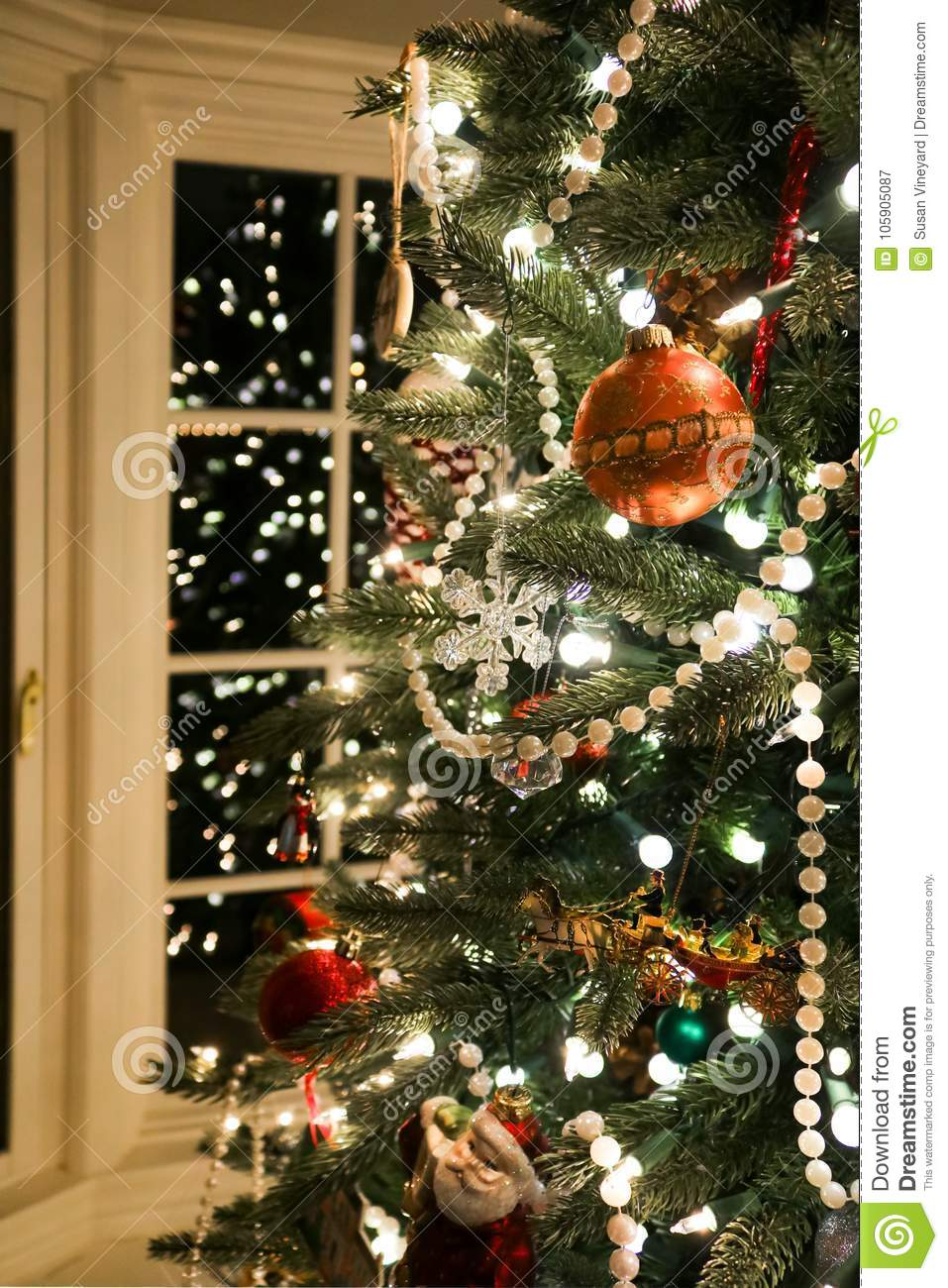 An Old Fashioned Christmas Tree Trimmed With Pearls And An ...