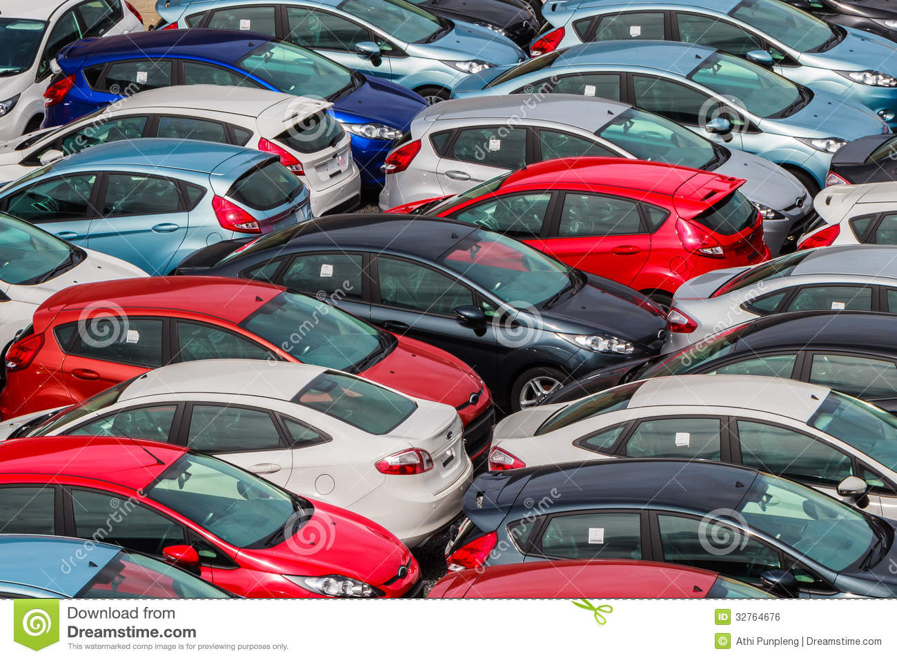 Brand new motor vehicles crowed in a parking lot