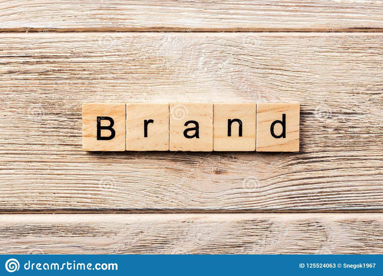 Brand word written on wood block. brand text on table, concept