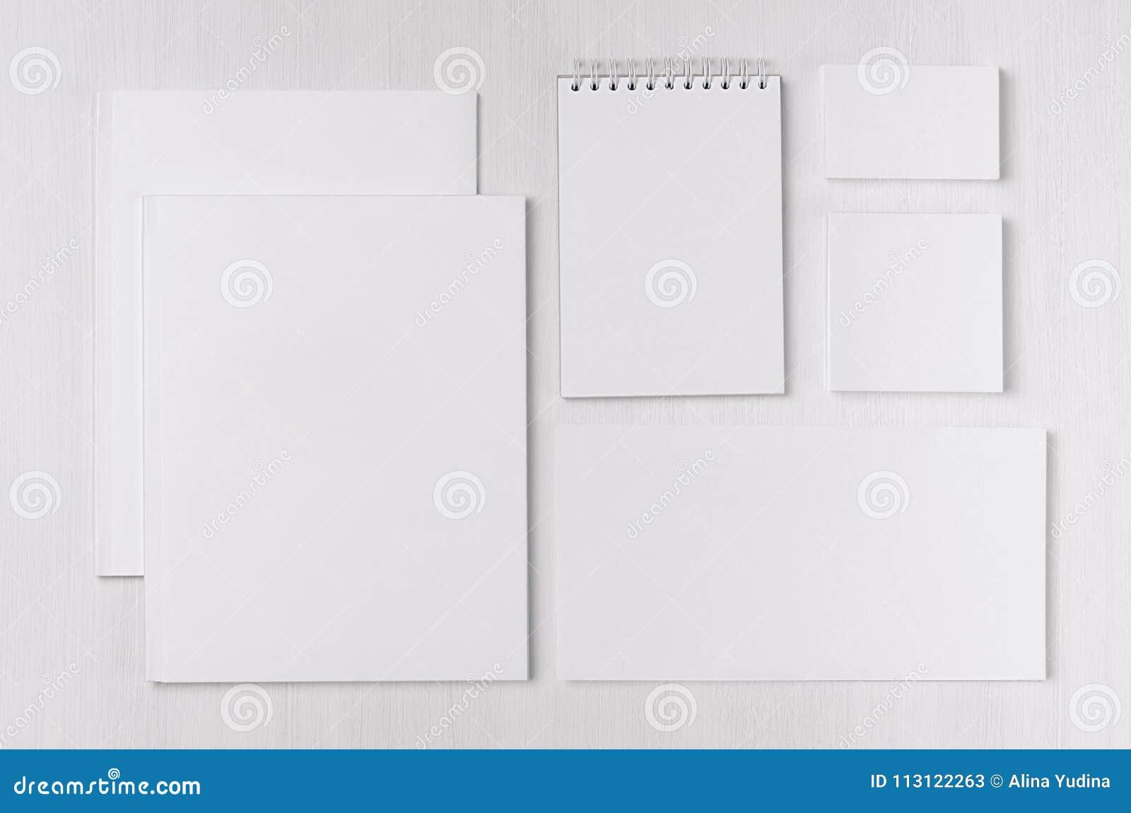 Branding business mock up of white blank stationery set on light soft white wooden background.