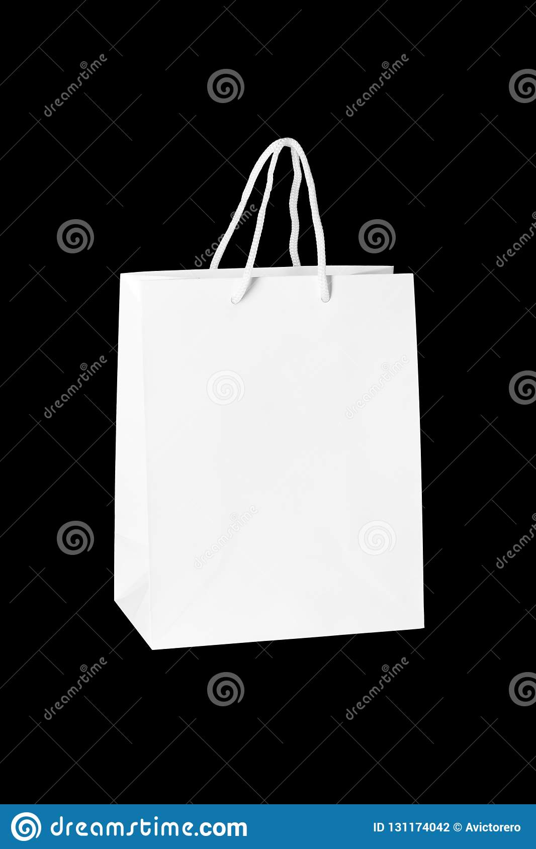 Mockup of paper shopping bag isolated on Black background