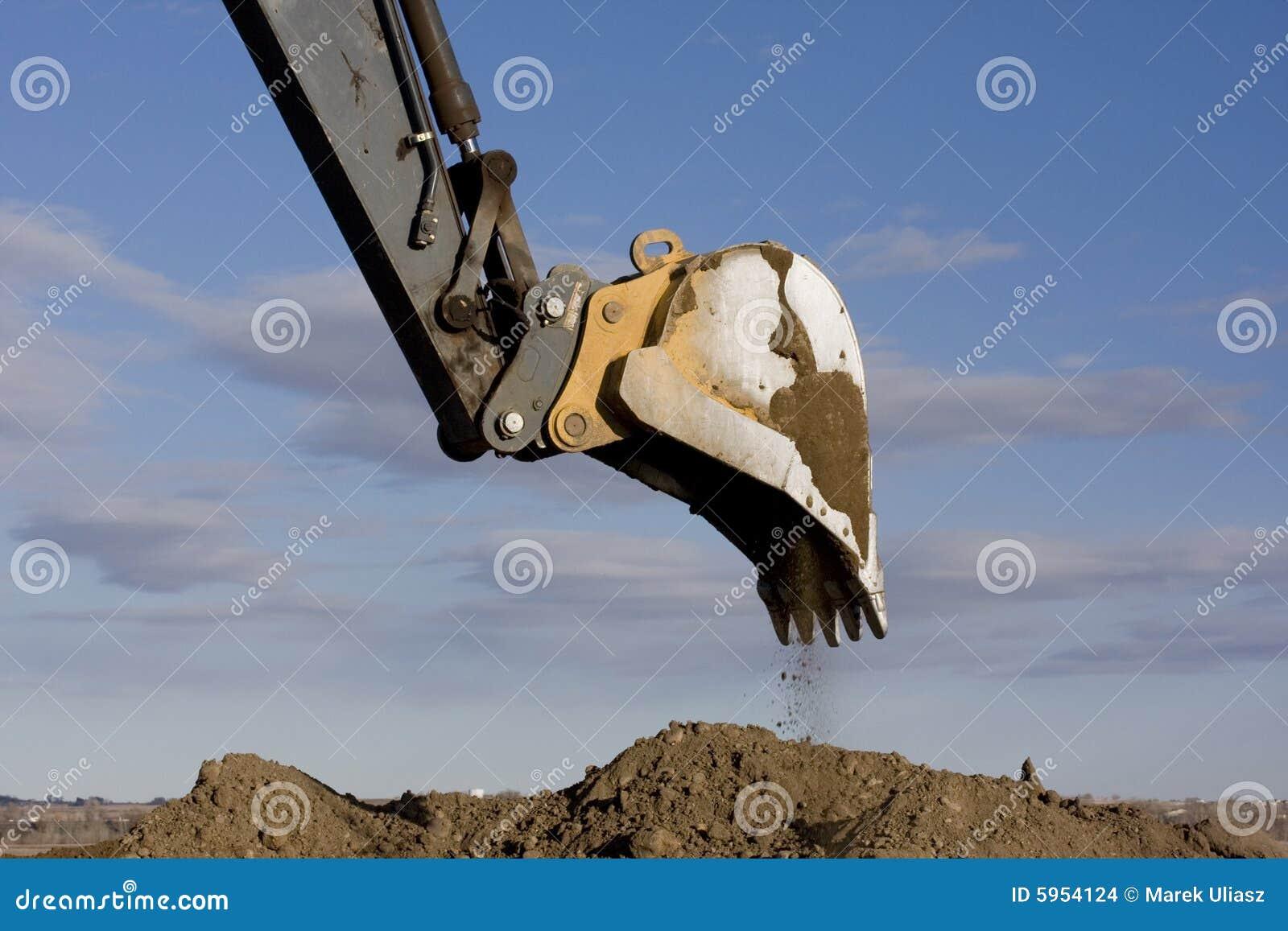 Bras d excavatrice et saleté de creusement d épuisette