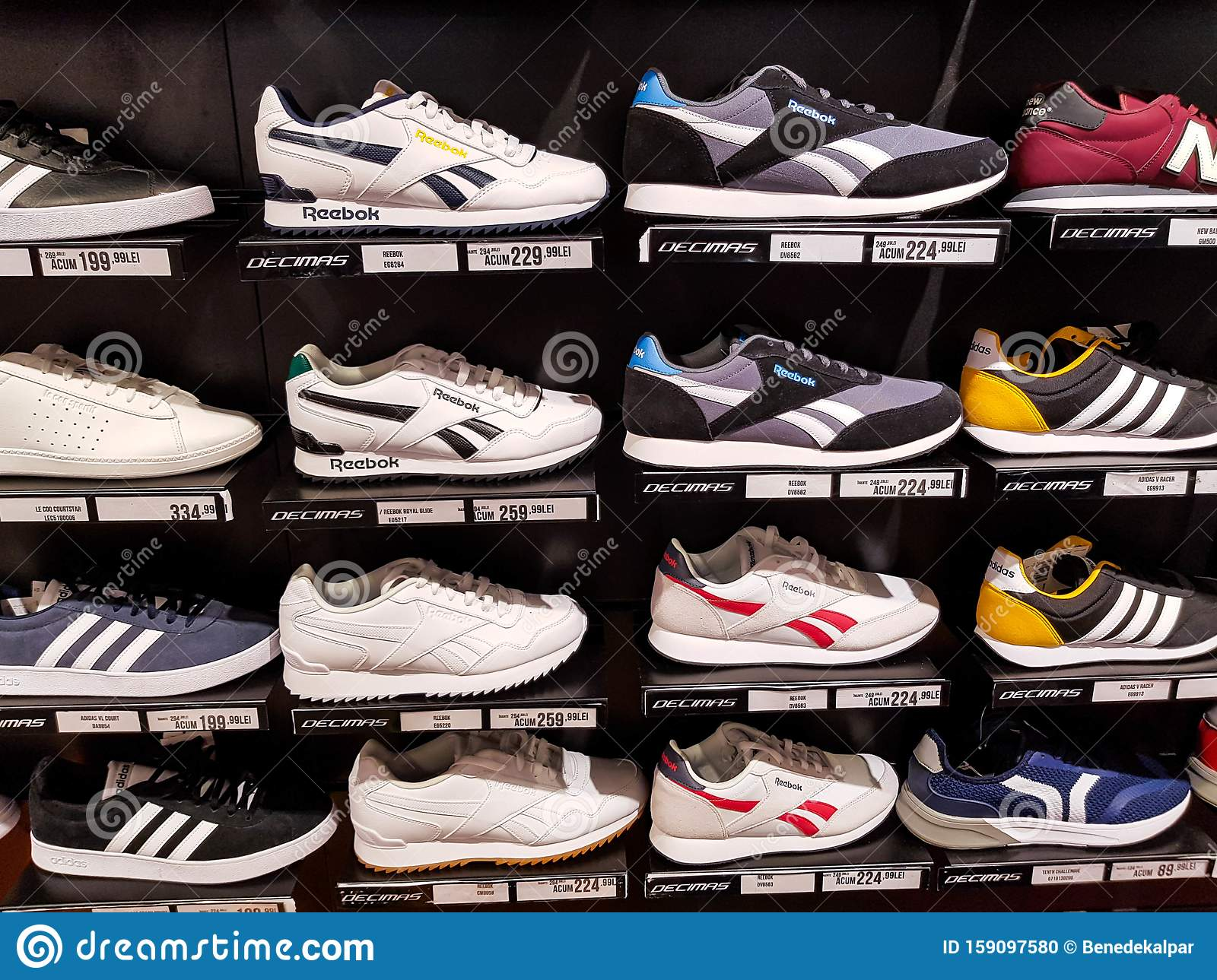 Adidas, Reebok Sport Shoes In Row At
