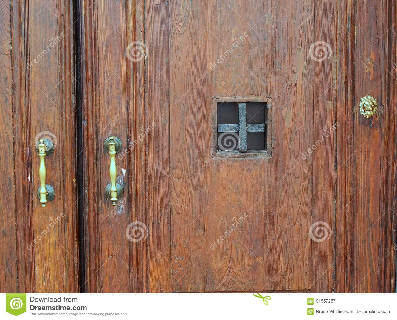 Brass Handles On Old Heavy Wooden Doors Stock Photo - Image: 91557257
