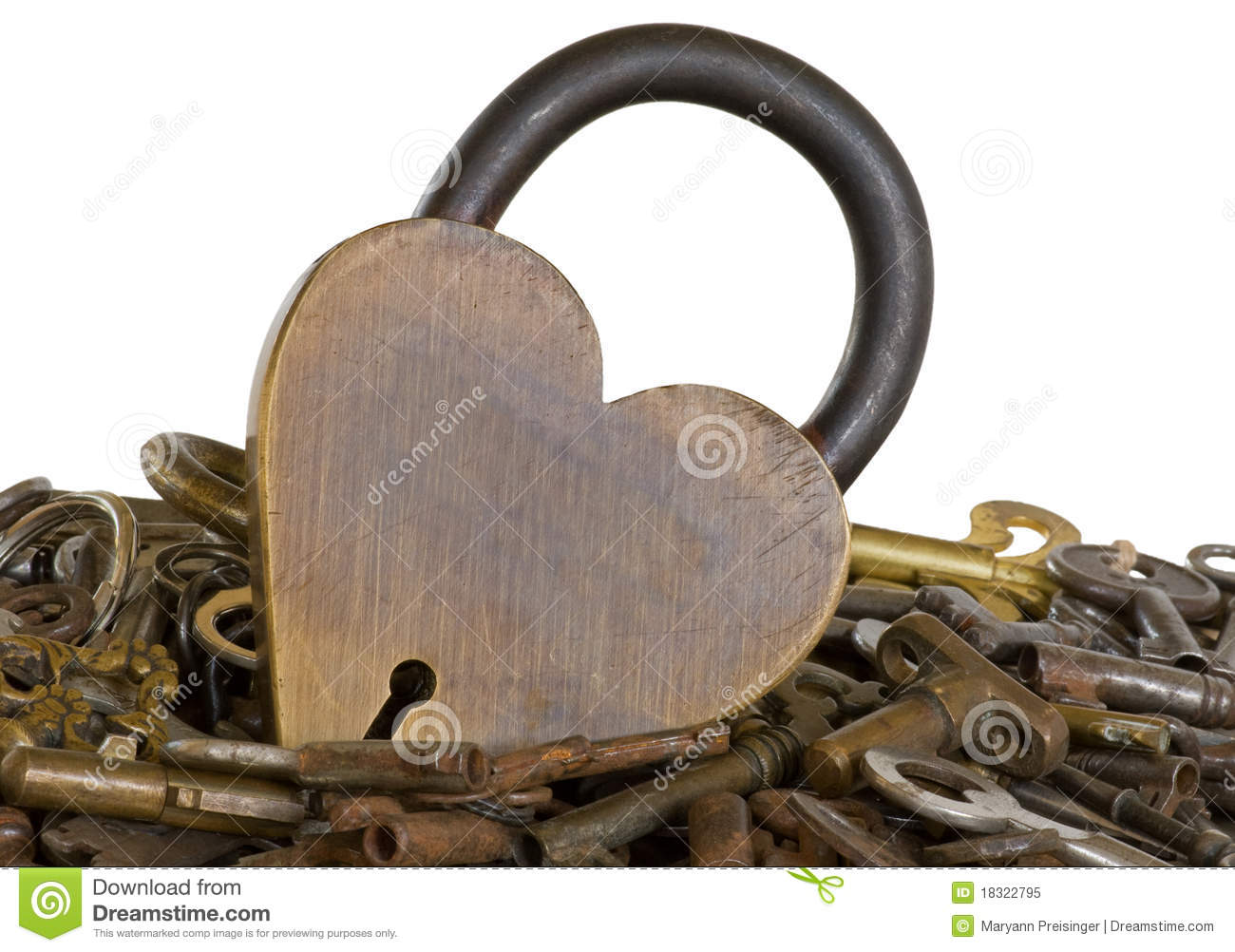 Brass heart lock surrounded by old keys isolated