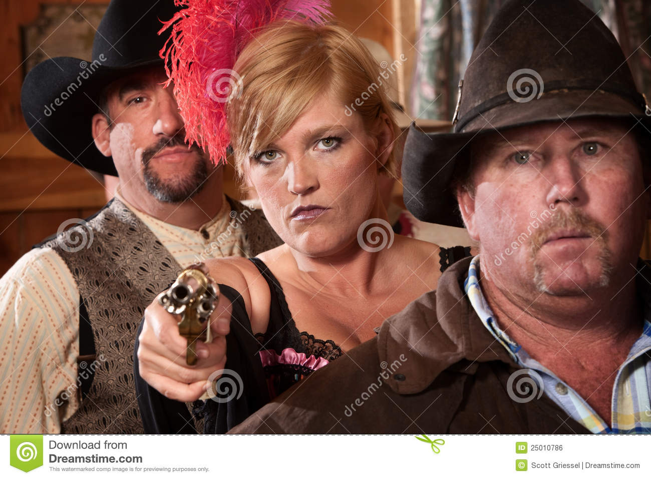 8fc582aaf1b84 Show girl between two men pulls out a revolver in old west saloon