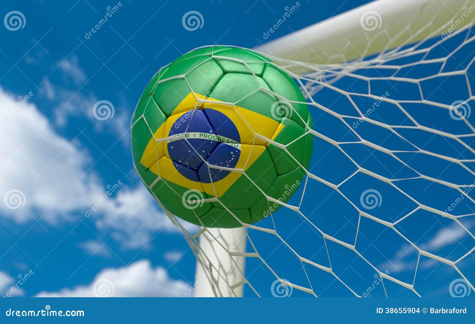 Brazil flag and soccer ball in goal net