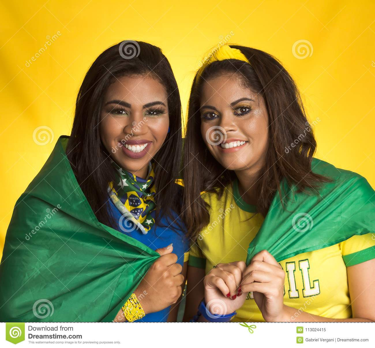 Two brazilian friends celebrating on soccer / football match on