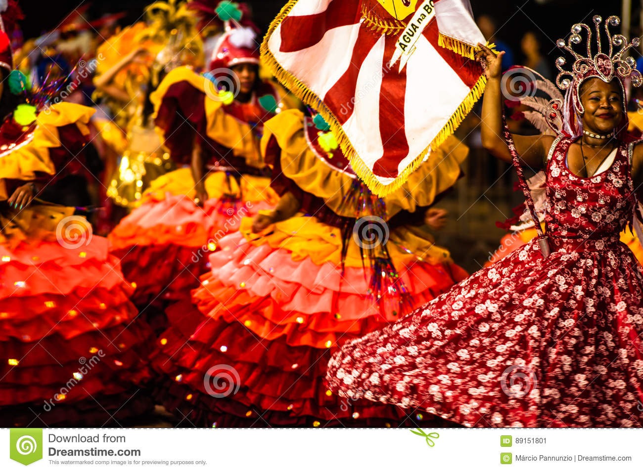 Brazilian Carnival. Parade of the Ita Lions samba school on the avenue in Ilhabela, Brazil, 02/28/2017. Artistic photo with select