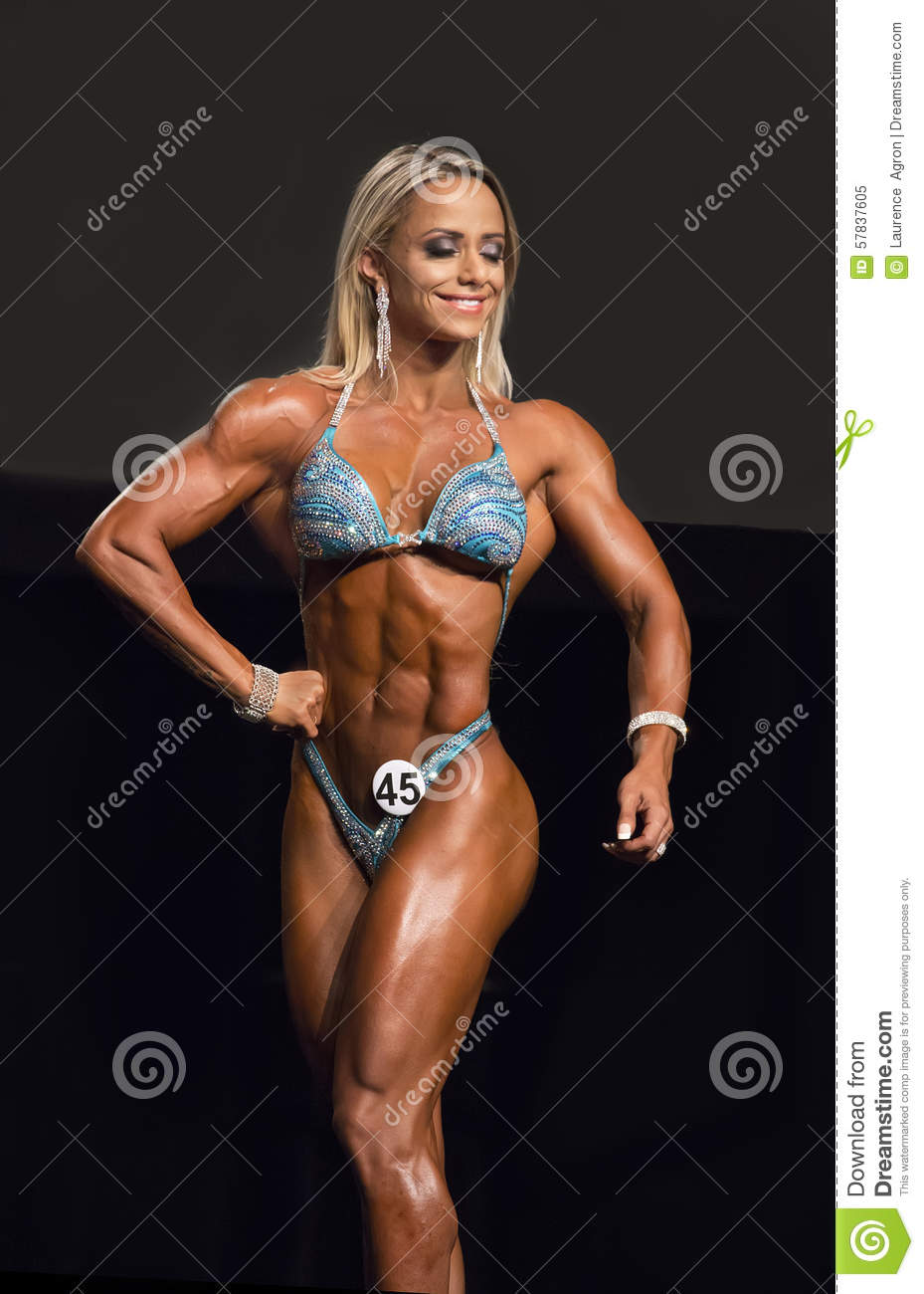 Brazilian bombshell Janaina Ferreira poses at the 2015 IFBB Vancouver  Pro/Am & Expo Figure competition on July 26, 2015.